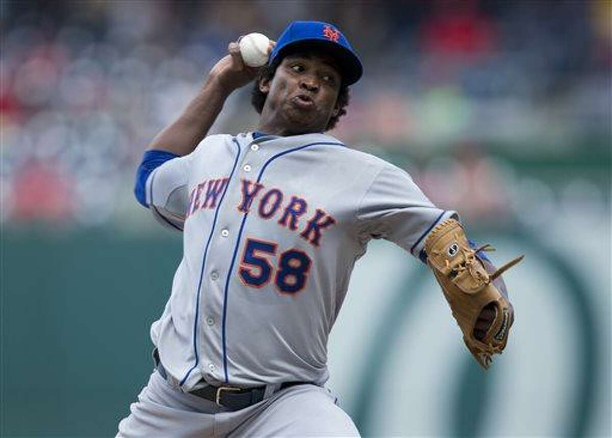 New York Mets starting pitcher Jenrry Mejia delivers a pitch during the fourth inning of a baseball game against the Washington Nationals at Nationals Park on Friday, July 26, 2013, in Washington. The Mets defeated the Nationals 11-0 in the first game of a doubleheader. (AP Photo/Evan Vucci)