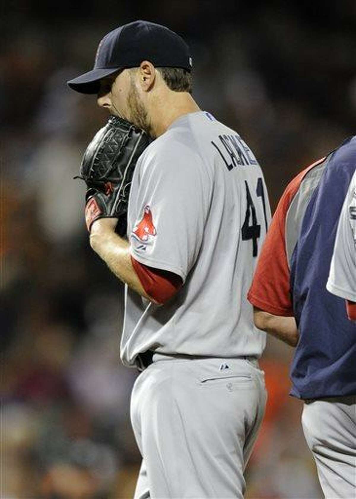 Boston Red Sox starting pitcher John Lackey (41) is pulled from a baseball game against the Baltimore Orioles during the seventh inning on Friday, July 26, 2013, in Baltimore. The Orioles won 6-0. (AP Photo/Nick Wass)