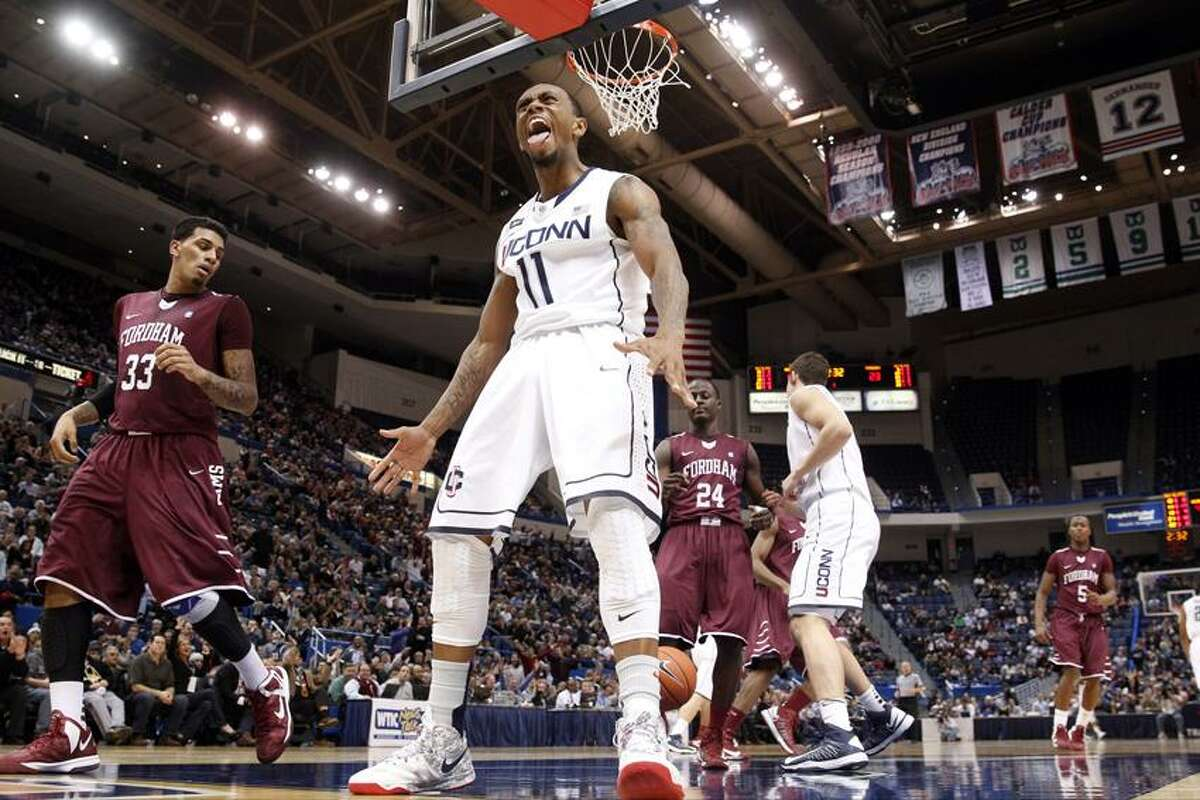 Dec 21, 2012; Hartford, CT, USA; Connecticut Huskies guard Ryan Boatright (11) reacts after a basket against Fordham Rams forward Chris Gaston (33) during the first half at the XL Center. UConn defeated the Fordham Rams 88-73. Mandatory Credit: David Butler II-USA TODAY Sports