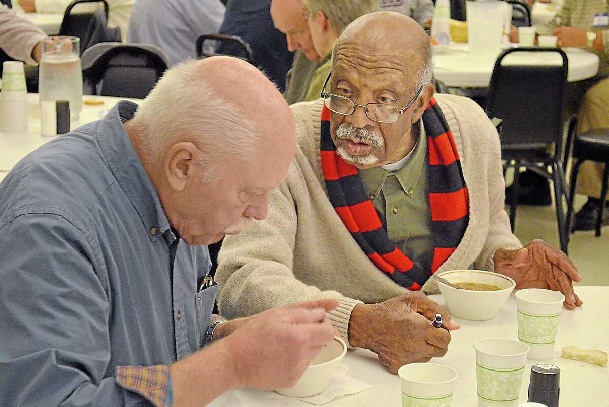 Jerome Long, right, Middletown resident and retired Wesleyan University professor, talks with John Statham, left, also of Middletown, at the Amazing Challenge Thursday evening. Brittany Hill — Middletown Press intern