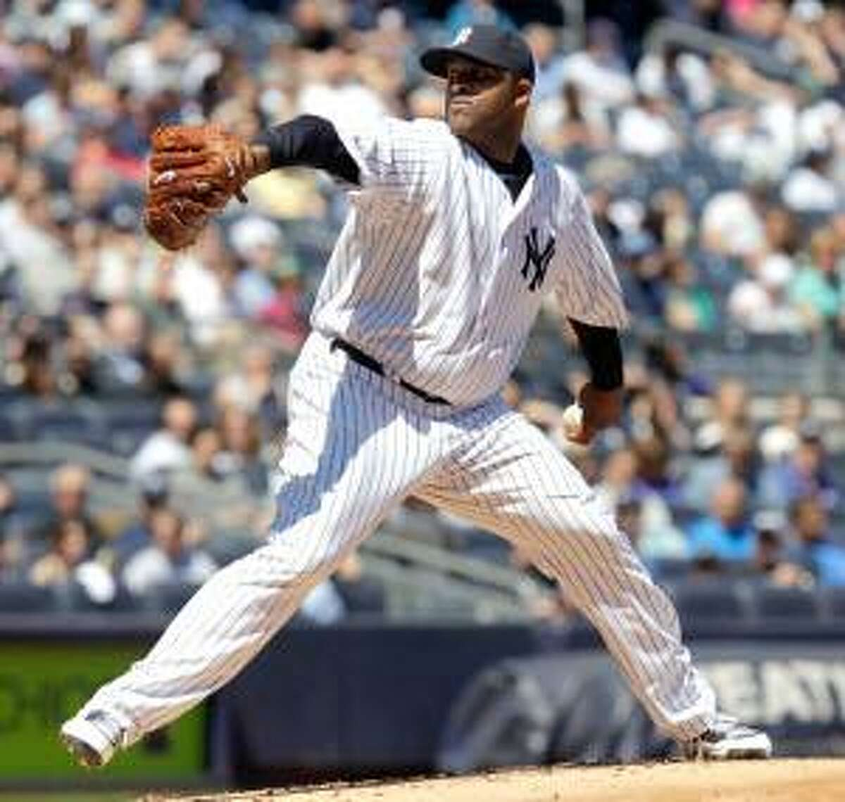 ASSOCIATED PRESS New York Yankees starting pitcher CC Sabathia winds up during the second inning of Sunday's game against the Detroit Tigers at Yankee Stadium in New York. The Yankees won the game 6-2.