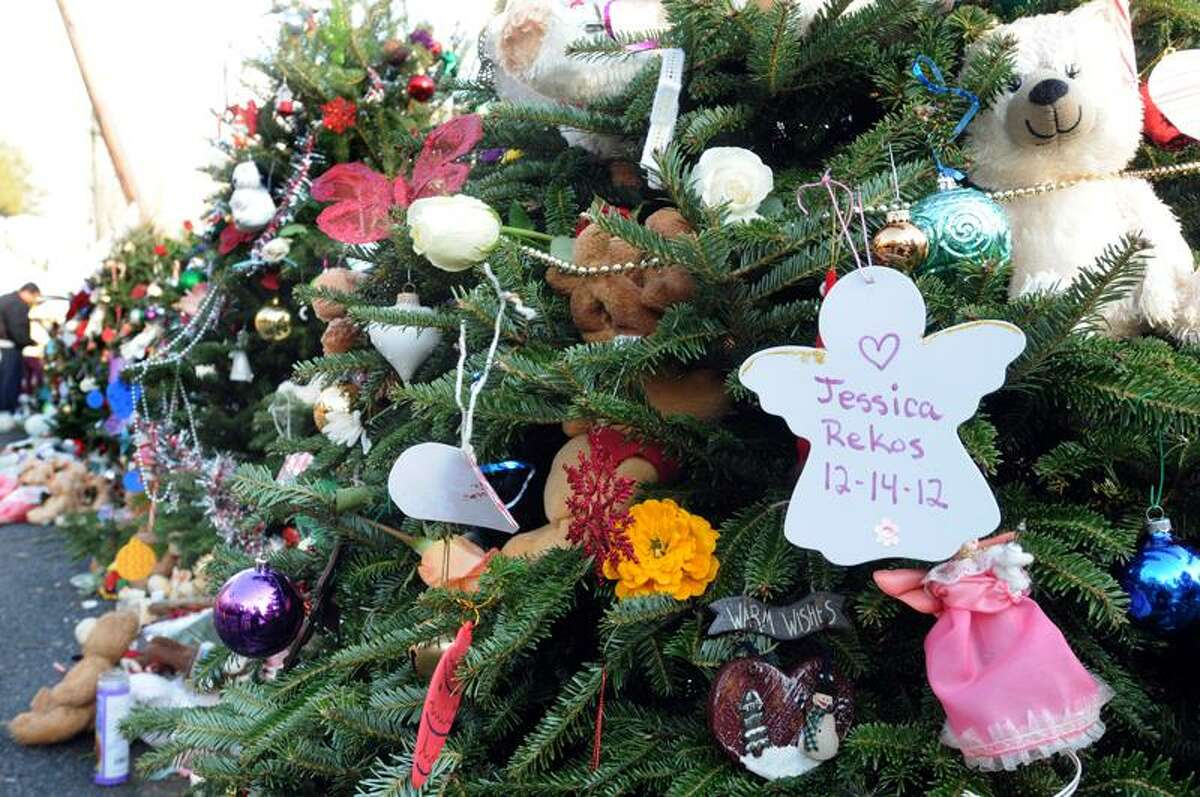 Sandy Hook, Newtown: Jessica Rekos was buried today. A Christmas tree was erected in her name at the makeshift memorial at the entrance to the Sandy Hook School. Mara Lavitt/New Haven Register12/18/12
