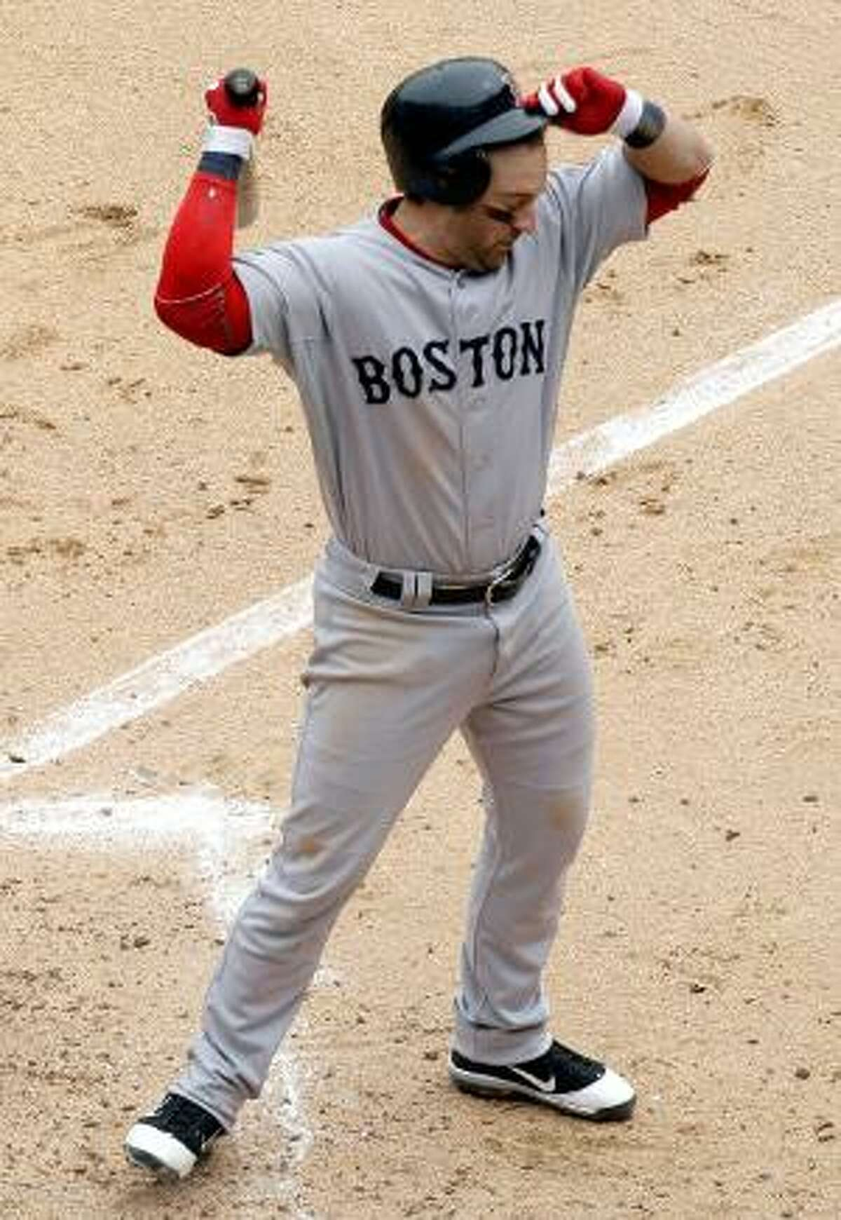 ASSOCIATED PRESS Boston Red Sox's Nick Punto reacts after being called out on strikes during the fifth inning of Sunday's game against the Chicago White Sox in Chicago. The Red Sox lost 4-1.