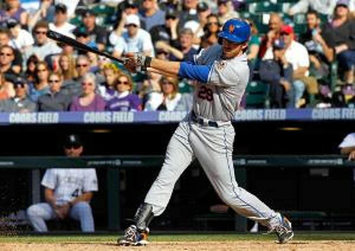 ASSOCIATED PRESS New York Mets first baseman Ike Davis follows the flight of his RBI-single off Colorado Rockies relief pitcher Matt Belisle in the 11th inning of the Mets' 6-5 victory in Denver on Sunday. Davis drove in David Wright with the single.