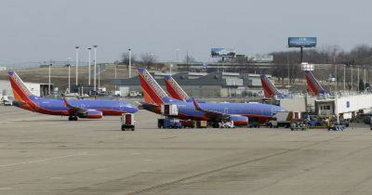Several Souhtwest Airlines planes are lined up at Terminal two at the Lambert - St. Louis International Airport, in St. Louis, Missouri, in this file photo from March 4, 2013.