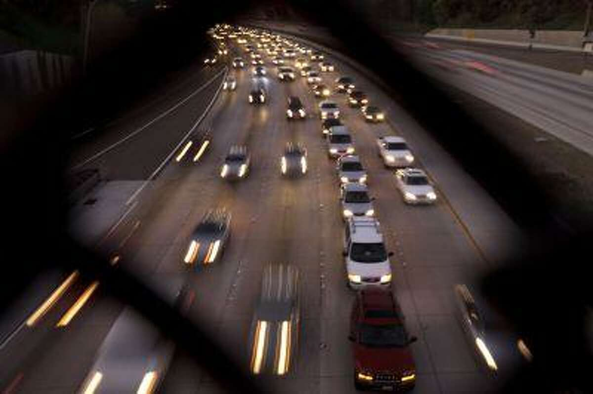 Cars fill the highway Tuesday, Nov. 22, 2011, in San Diego. (AP Photo/Gregory Bull)