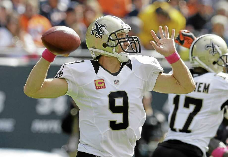 New Orleans Saints quarterback Drew Brees throws a pass against the Bears on Sunday in Chicago. Photo: Nam Y. Huh — The Associated Press  / AP