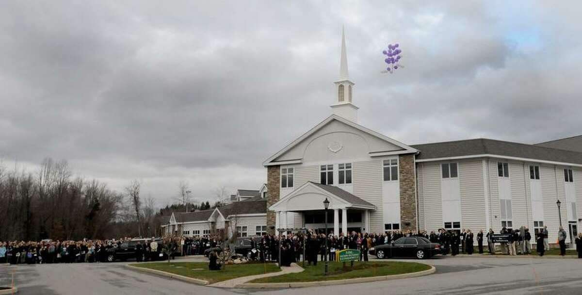 Ballons are released near the end of a memorial service Friday, December 21, 2012 at the Walnut Hill Community Church in Bethel, Conn. for their son Dylan Hockley, 6, who was a victim of the Sandy Hook Elementary School mass shooting by gunman Adam Lanza, a neighbor, that claimed the lives of 6 adults and 19 other children shooting in Sandy Hook, Conn. Friday, December 15, 2012. Photo by Peter Hvizdak / New Haven Register