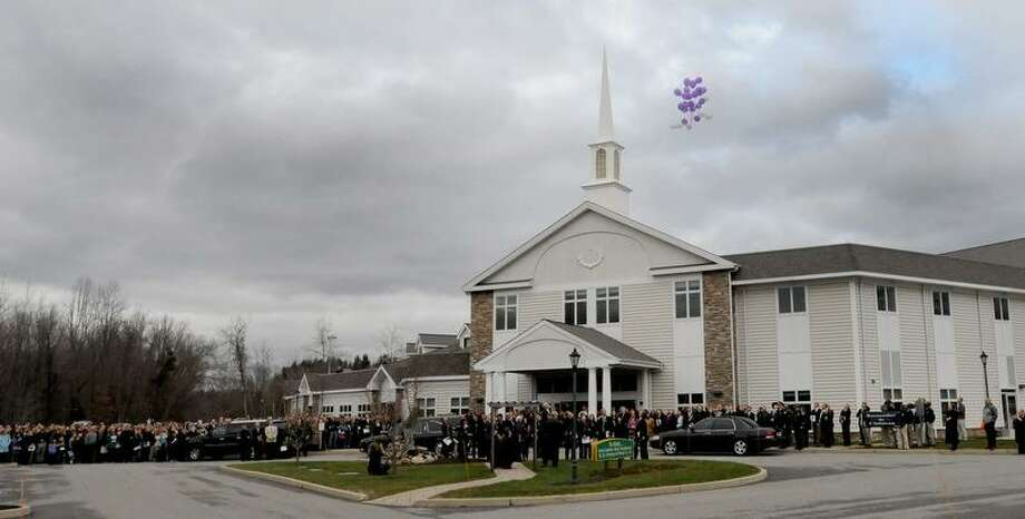 Ballons are released near the end of a  memorial service  Friday, December 21, 2012 at the Walnut Hill Community Church in  Bethel, Conn. for their son  Dylan Hockley, 6,  who was a victim of the Sandy Hook Elementary School mass shooting by gunman Adam Lanza, a neighbor,  that claimed the lives of 6 adults and 19 other children shooting in Sandy Hook, Conn. Friday, December 15, 2012.   Photo by Peter Hvizdak / New Haven Register Photo: New Haven Register / ©Peter Hvizdak /  New Haven Register