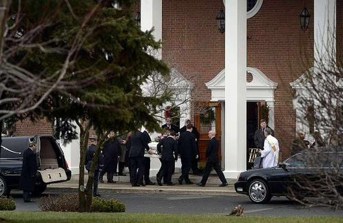 Pallbearers carry the casket of Olivia Engel, 6, into St. Rosa Lima church in Newtown for her funeral December 21, 2012. Engel was one of the 26 Sandy Hook Elementary school victims from the Friday mass shooting. Photo by Mahala Gaylord