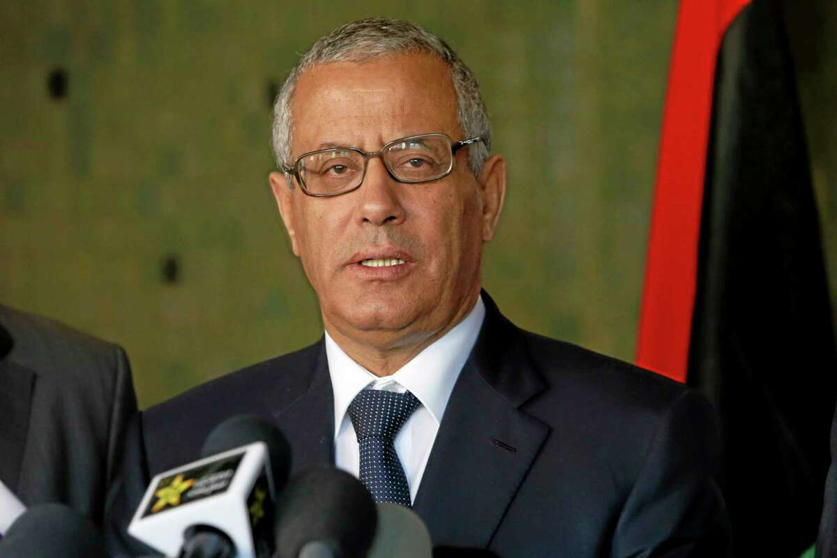 In this Tuesday, Oct. 8, 2013 file photo, Libyan's Prime Minister Ali Zidan speaks to the media during a press conference in Rabat, Morocco. Zidan was snatched by gunmen before dawn Thursday from a Tripoli hotel where he resides, the government said. The abduction appeared to be in retaliation for the U.S. special forces' raid over the weekend that seized a Libyan al-Qaida suspect from the streets of the capital. (AP Photo/Abdeljalil Bounhar)