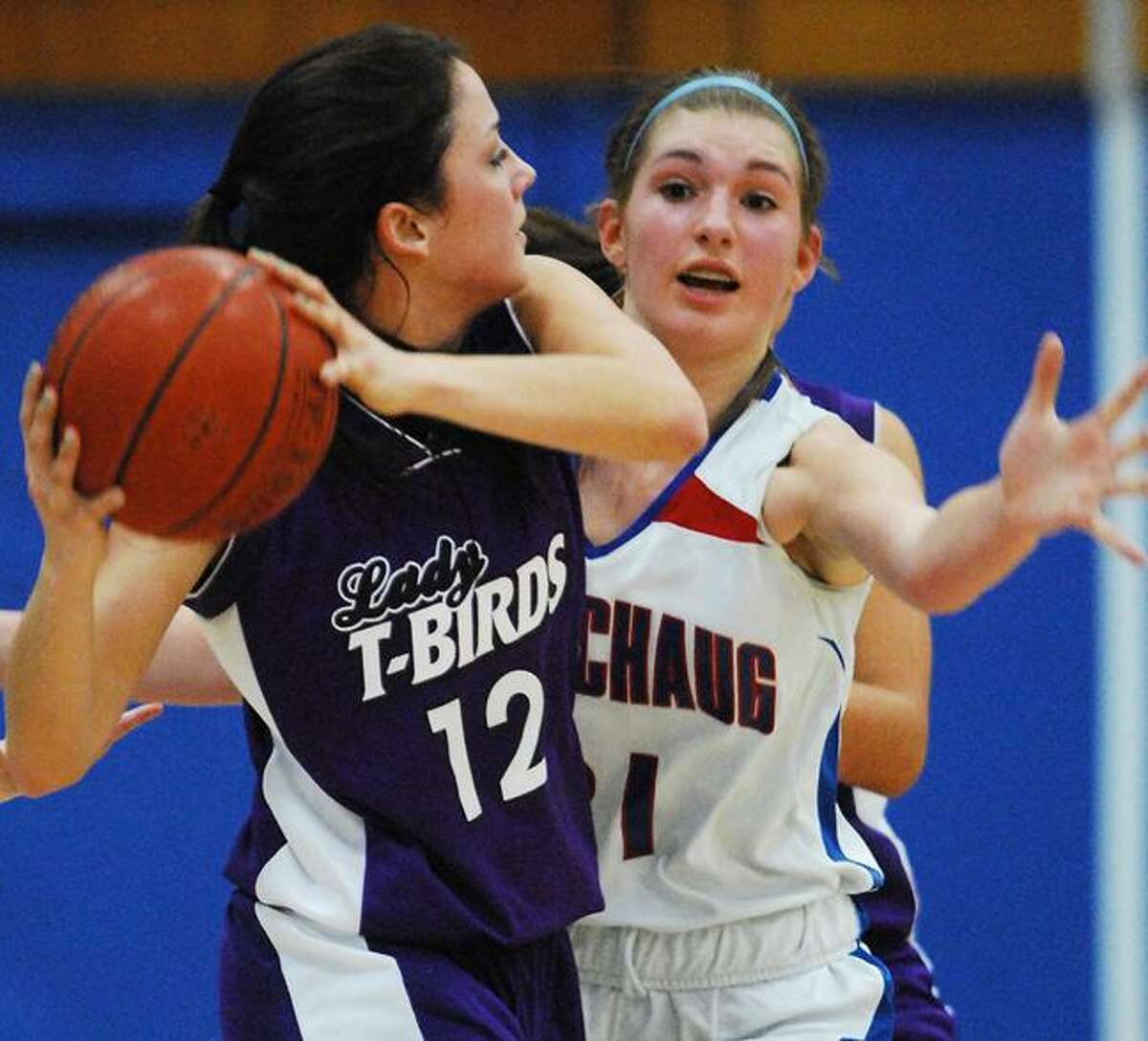 Catherine Avalone/The Middletown Press Coginchaug junior forward Caryn Sibiskie defends against North Branford's Ashley Arre in the first half of the Devils' 46-34 win Friday night in Durham.
