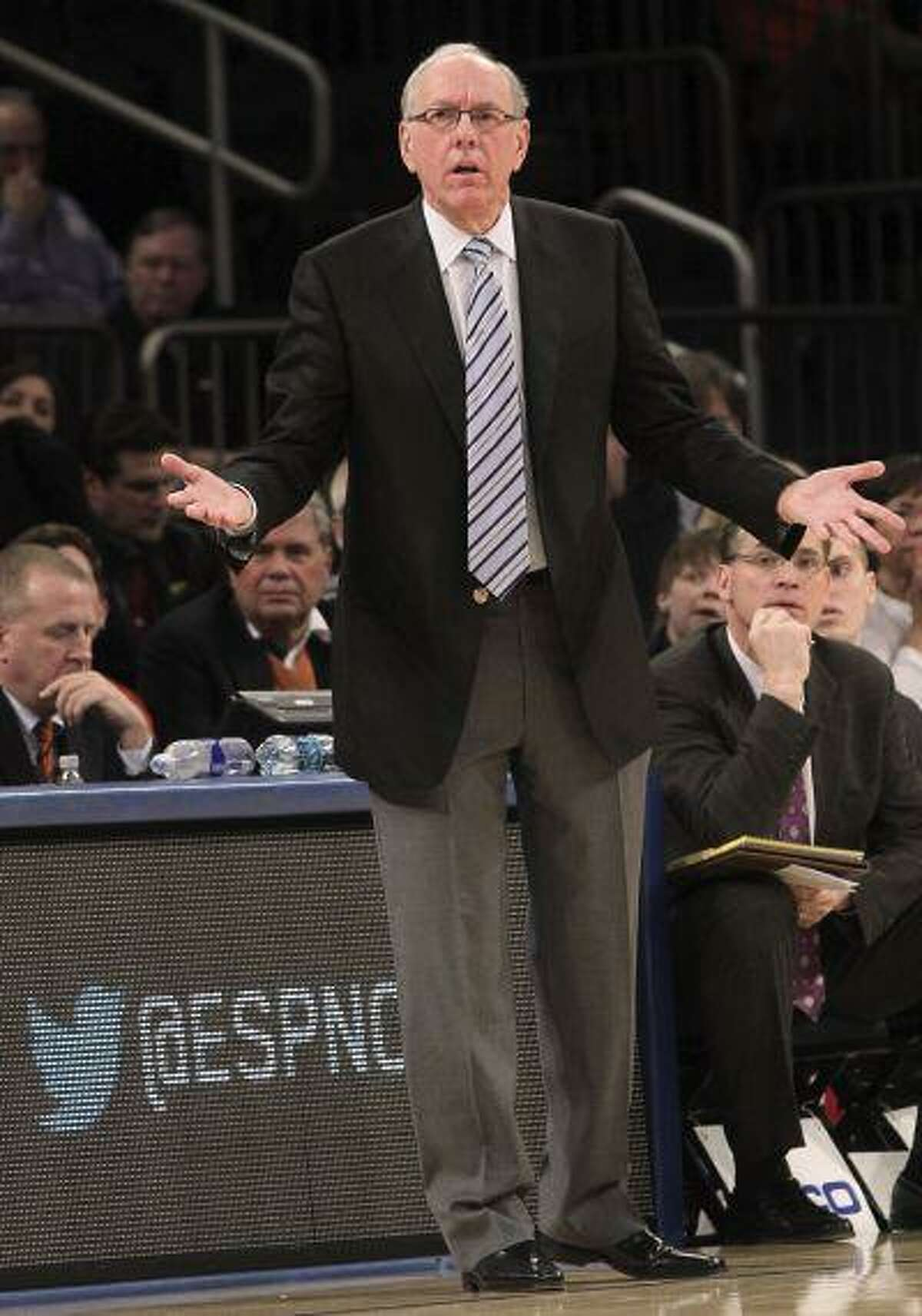 Syracuse head coach Jim Boeheim gestures during the first half of an game against Seton Hall at the Big East Conference tournament, in New York, March 13, 2013.