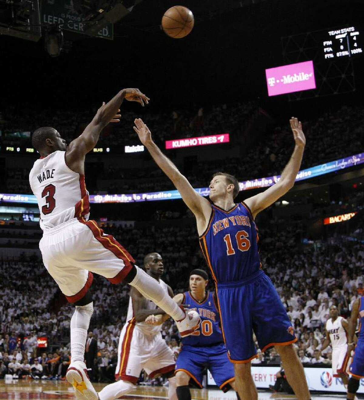 ASSOCIATED PRESS Miami Heat guard Dwyane Wade (3) shoots over New York Knicks forward Steve Novak (16) in the first half of Game 1 of their first round NBA playoff series in Miami, Saturday. The Heat won the game 100-67.