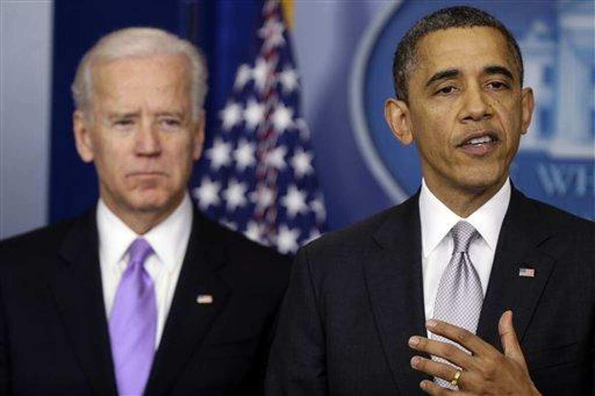President Barack Obama stands with vice president Joe Biden as he makes a statement Wednesday in the Brady Press Briefing Room at the White House in Washington, about policies he will pursue following the massacre at Sandy Hook Elementary School in Newtown, Ct. Obama is tasking Vice President Joe Biden, a longtime gun control advocate, with spearheading the effort. AP Photo/Charles Dharapak