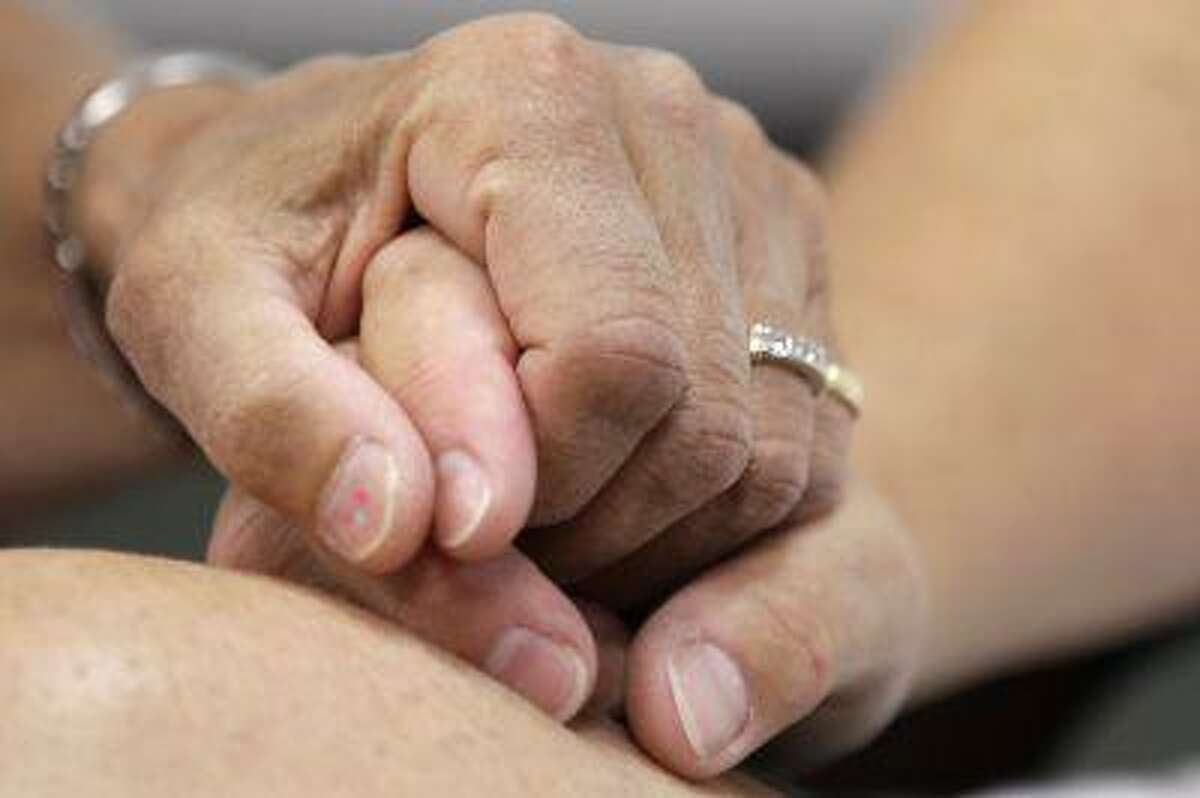 Ellen Toplin and Charlene Kurland hold hands as they obtain a marriage license at a Montgomery County office despite a state law banning such unions, Wednesday, July 24, 2013, in Norristown, Pa.