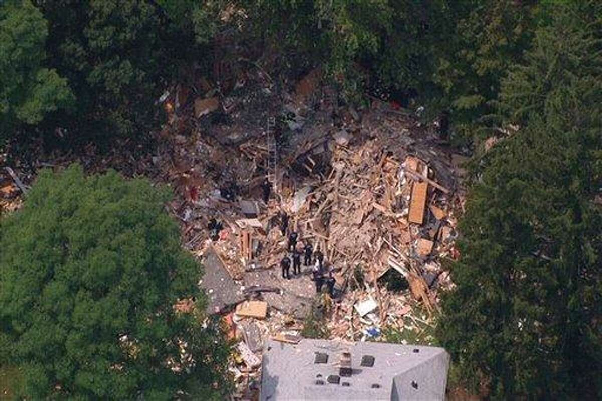 This image taken from video provided by News 12 Long Island shows the wreckage of a house that was destroyed Tuesday by an apparent gas-related explosion, killing a toddler and sending 14 other people to hospitals, in the Long Island town of Brentwood, N.Y. The entire structure of the house, situated on a block of well-kept, modest homes, was reduced to small shards of wood, plywood, drywall, insulation and other building material. (AP Photo/News 12 Long Island)