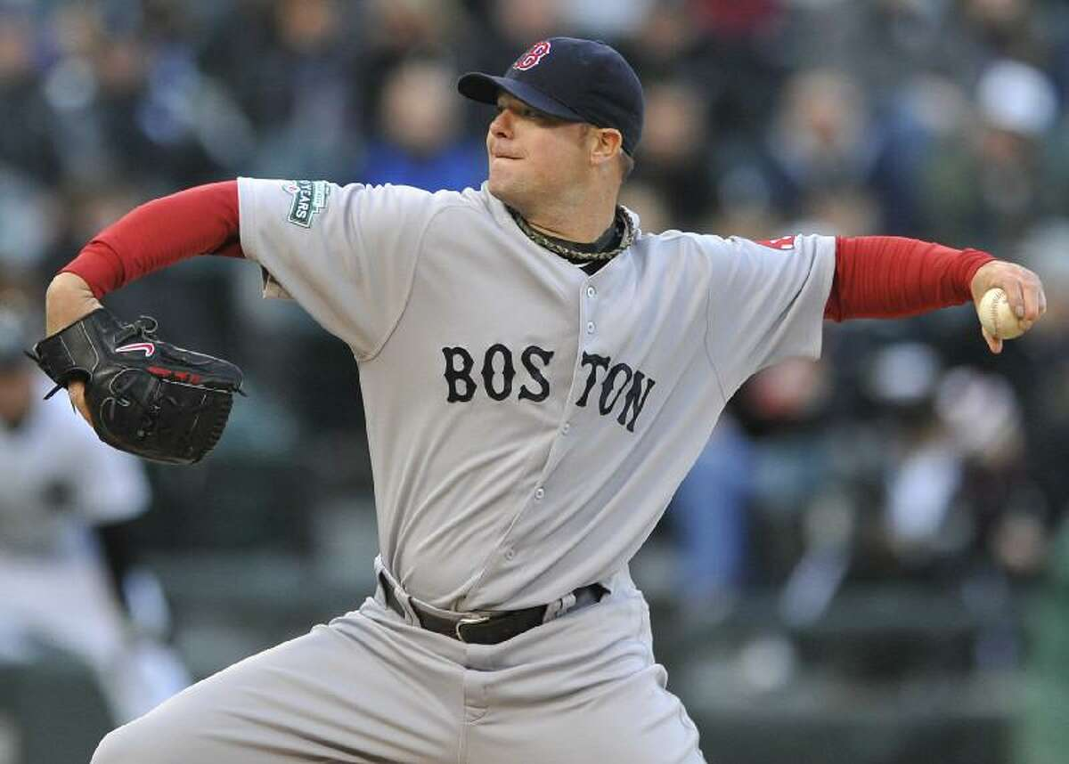 ASSOCIATED PRESS Boston Red Sox starter Jon Lester delivers a pitch against the Chicago White Sox in the first inning of Saturday night's game in Chicago. The Red Sox won 1-0.