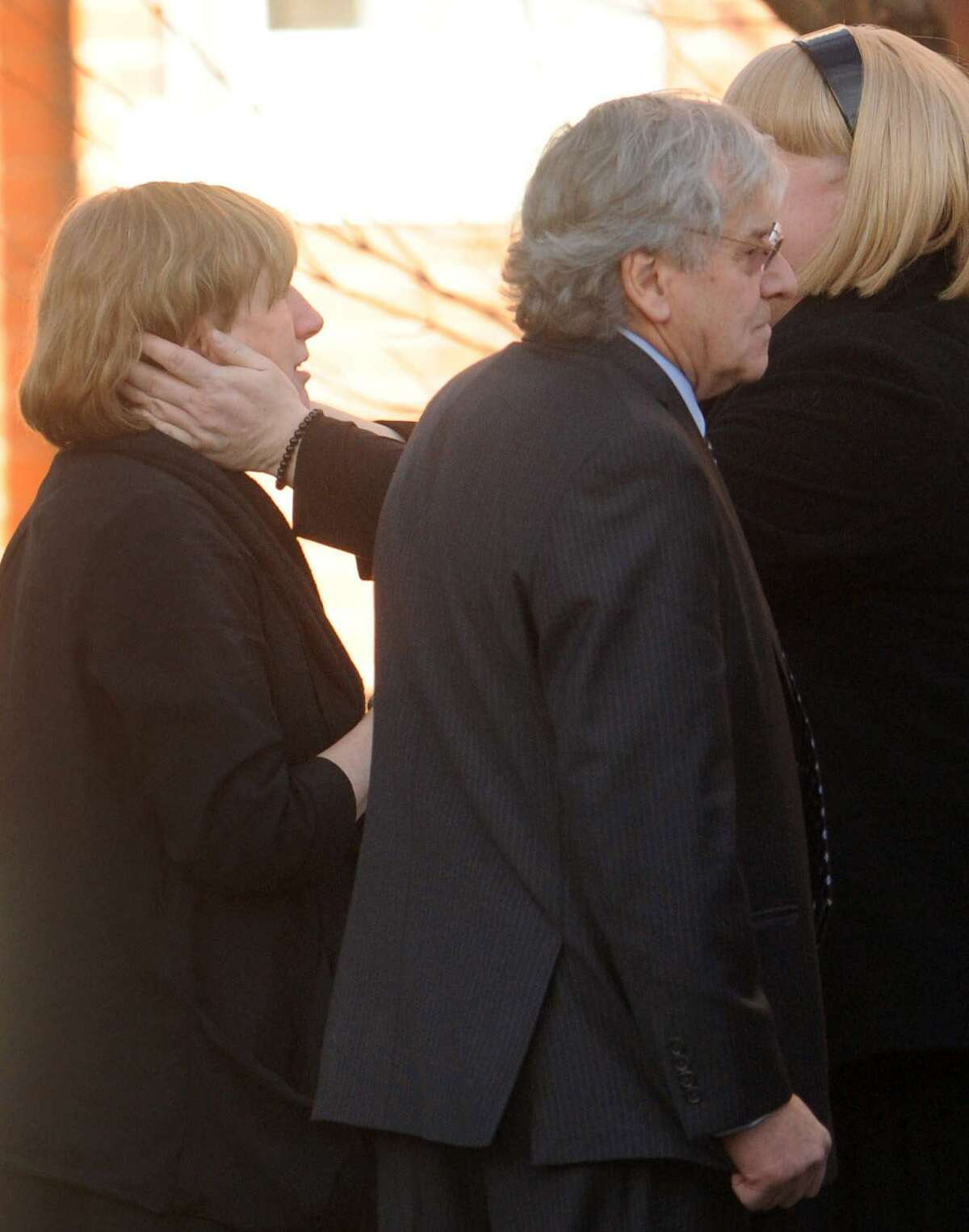 Teresa Rousseau, left, is comforted with conversation by a mourner, as Gilles Rousseau, second from left, waits with his ex-wife after a memorial service for their daughter Lauren Rousseau at the First Congregational Church in Danbury, Conn. Thursday, December 20, 2012. Rousseau was a substitute teacher killed by a gunman that also claimed the lives of 5 other educators and 20 children at the Sandy Hook Elementary School shooting Friday, December 15, 2012. Lauren and Gilles Rousseau are divorced. Photo by Peter Hvizdak / New Haven Register