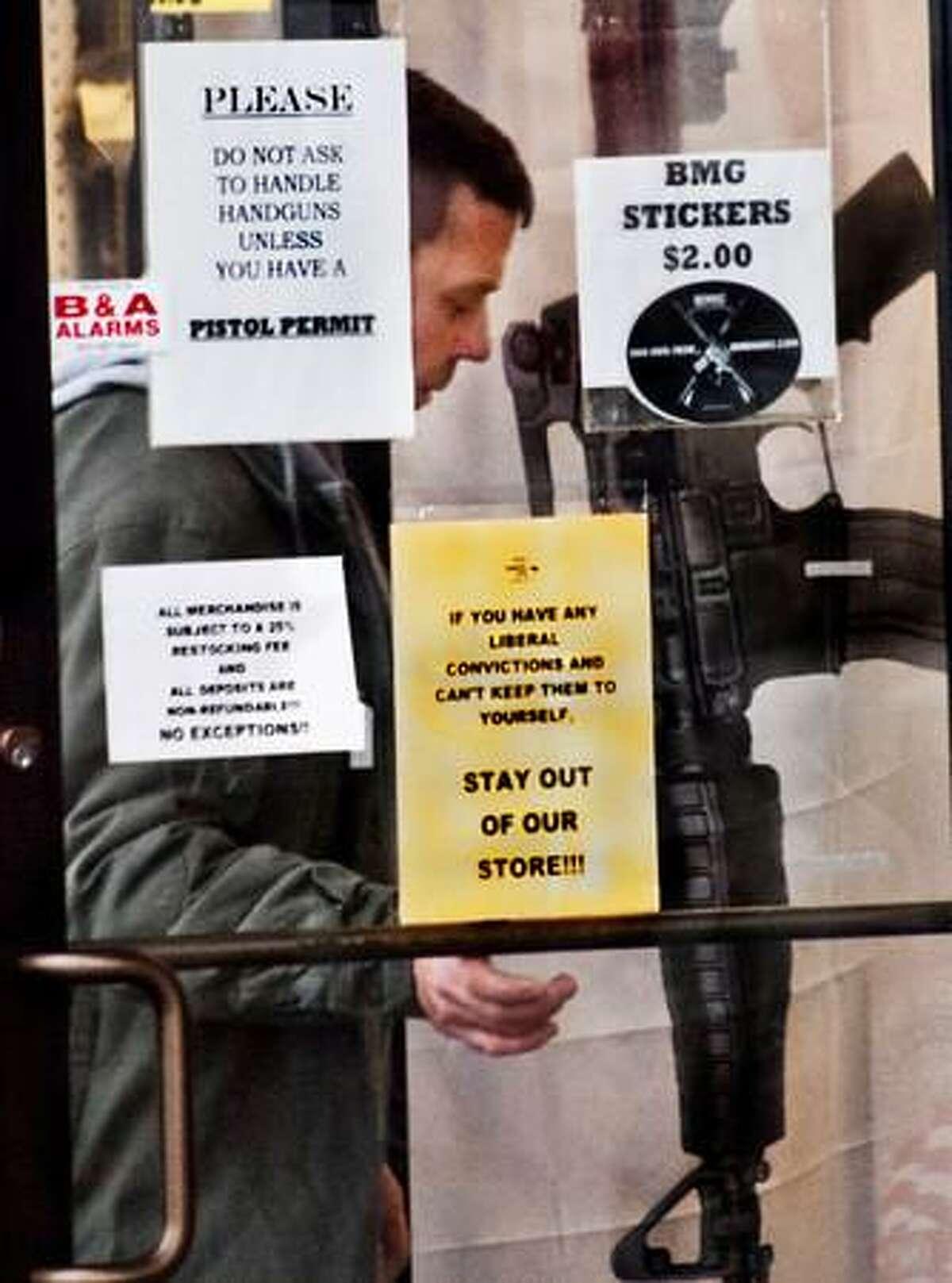 Newington-A man walks into BMG gun shop, in Newington. Melanie Stengel/Register