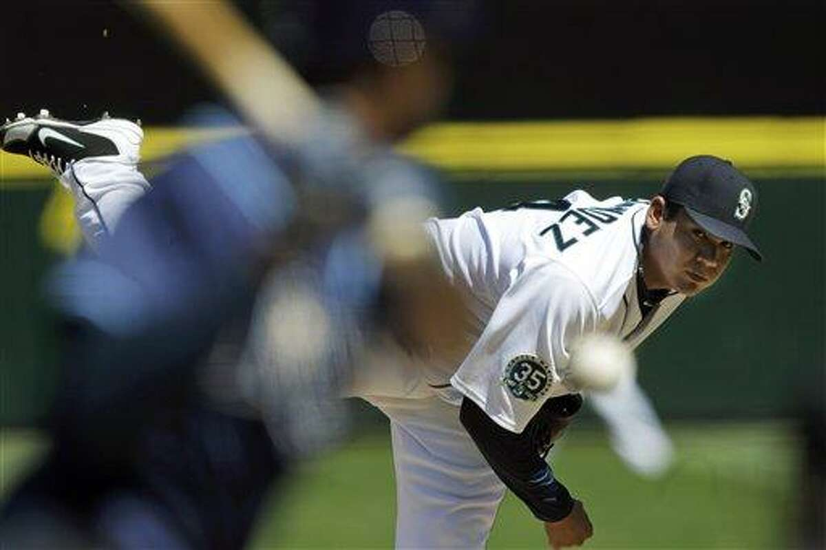 Seattle Mariners starting pitcher Felix Hernandez throws against the Tampa Bay Rays in the fourth inning of a baseball game, Wednesday, Aug. 15, 2012, in Seattle. (AP Photo/Ted S. Warren)