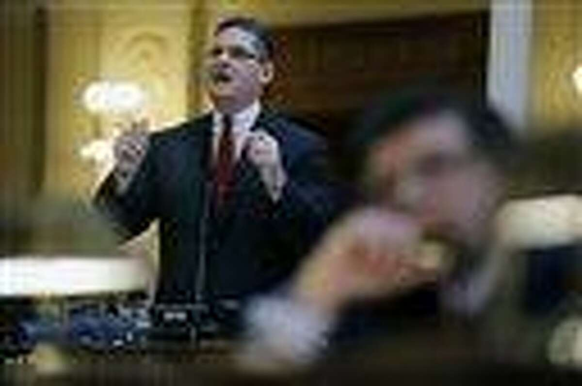 New Jersey Assemblyman Louis D. Greenwald, D-Voorhees, N.J., stands in the Statehouse in Trenton, N.J., Thursday, Feb. 21, 2013, as talks about his bill to reduce the number of rounds allowed in a gun magazine from 15 to 10. Greenwald's bill passed as the Assembly began voting on nearly two dozen measures proponents say will curb gun violence. The bills are being fast-tracked through the chamber following the Newtown, Conn. School shootings in December. (AP Photo/Mel Evans)