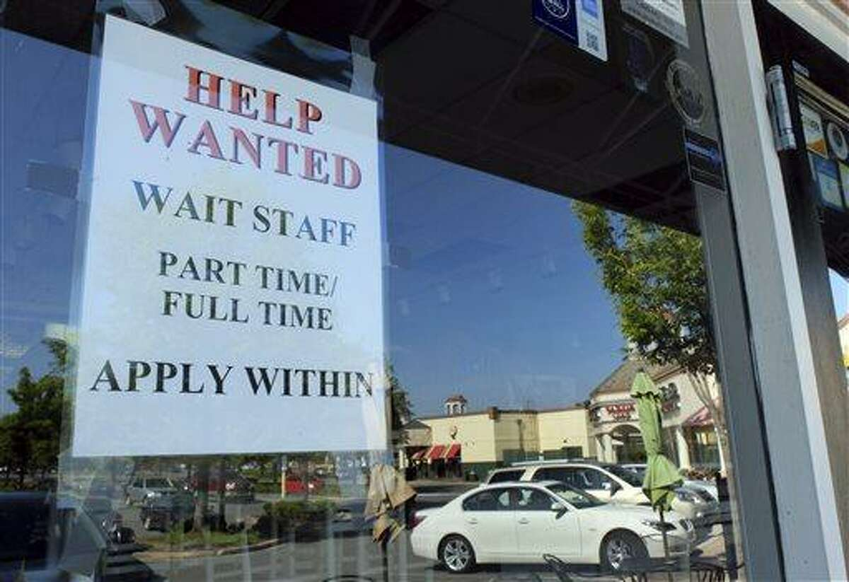 A Help Wanted sign is displayed June 21 in the window of a restaurant at a shopping center in Charlotte, N.C. Associated Press file photo