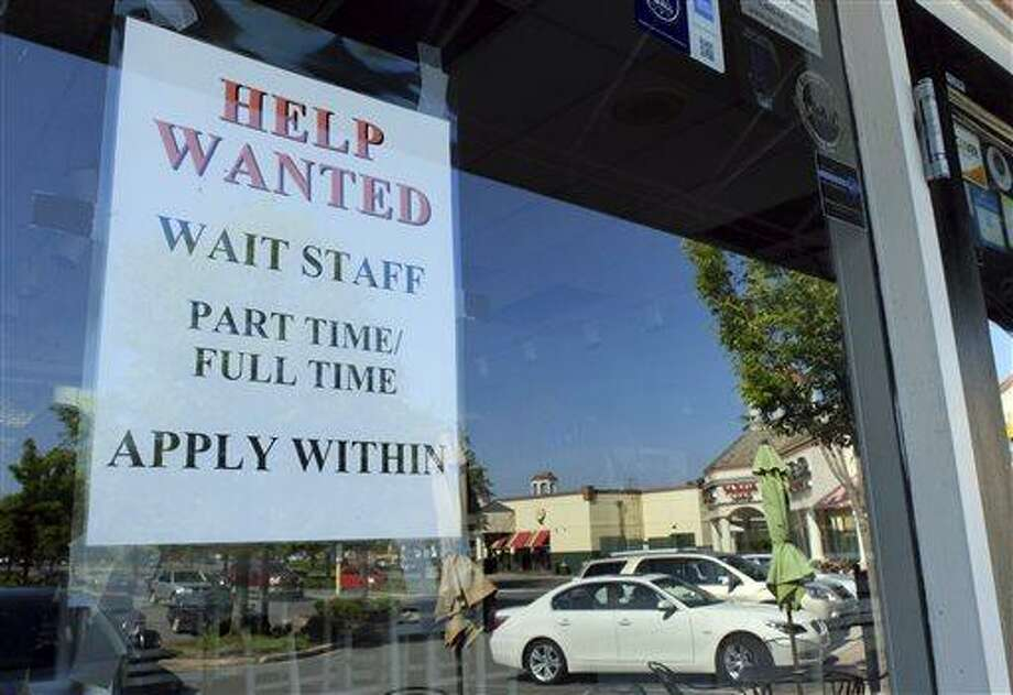 A Help Wanted sign is displayed June 21 in the window of a restaurant at a shopping center in Charlotte, N.C. Associated Press file photo Photo: AP / AP