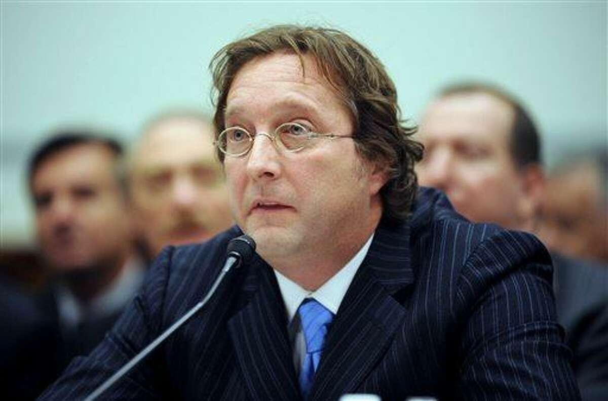 FILE - In this Thursday, Nov. 13, 2008, file photo, Senior Managing Partner of Harbinger Capital Partners Philip Falcone testifies on Capitol Hill in Washington. before the House Oversight and Government Reform Committee hearing on