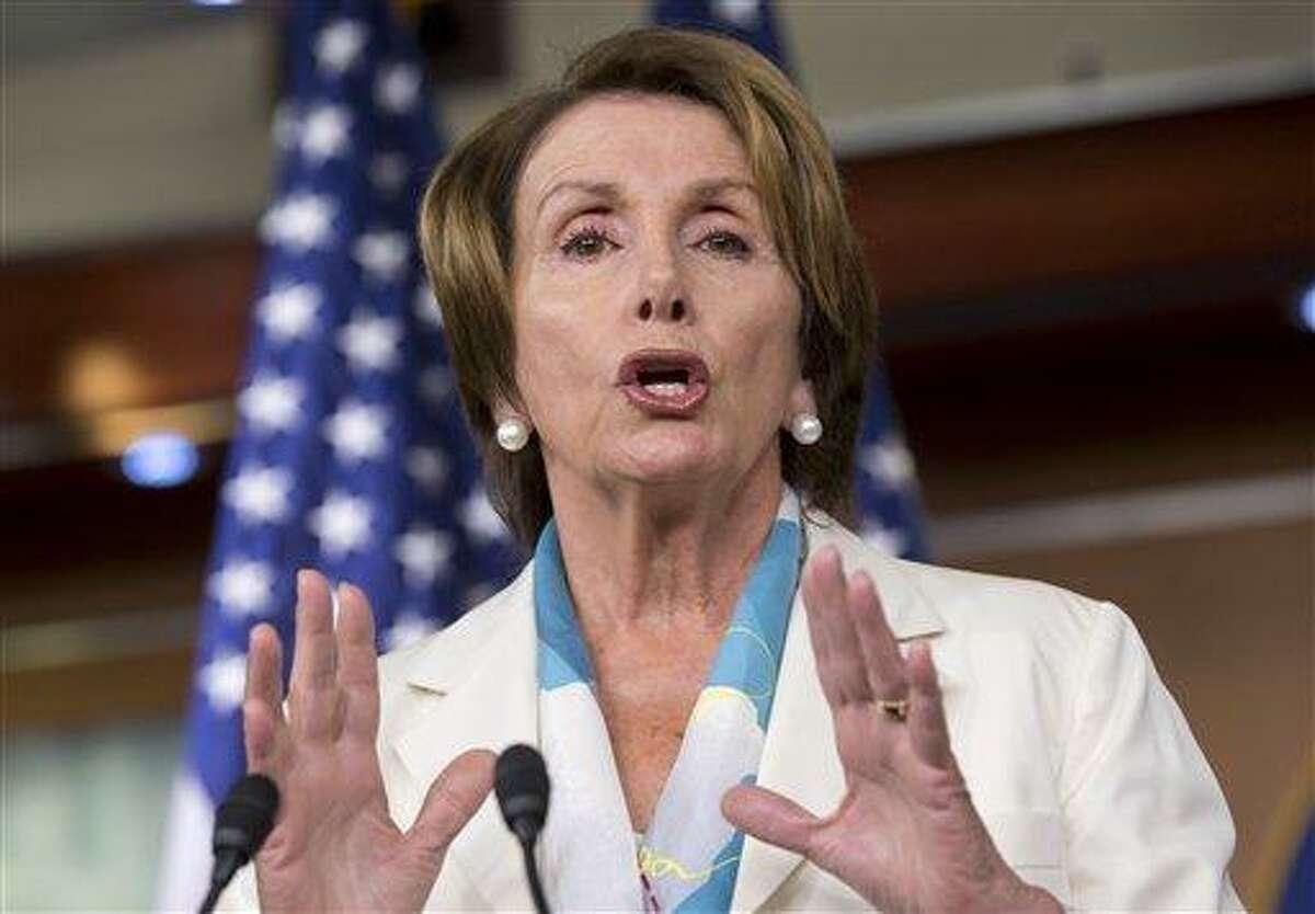House Minority Leader Nancy Pelosi of Calif. speaks to reporters on Capitol Hill in Washington, Thursday, July 11, 2013. (AP Photo/J. Scott Applewhite)