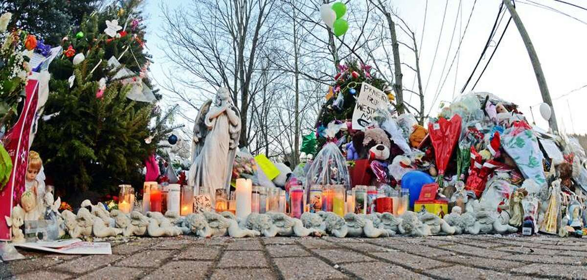 Staff photos by Tom Kelly IVThe memorials in downtown Sandy Hook continue to grow as seen here early Thursday morning December 20, 2012.