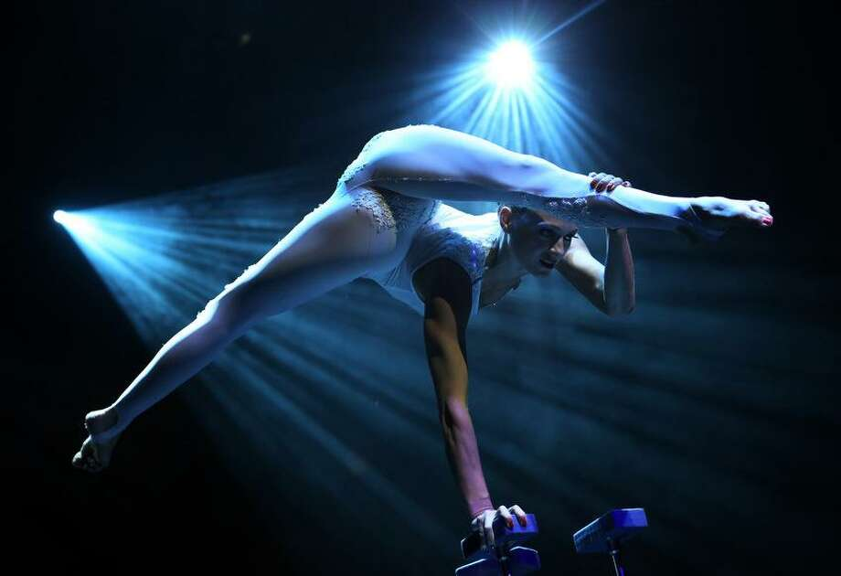 A member from the production Le Noir performs at the Marina Bay Sands on Tuesday March 12, 2013 in Singapore. Le Noir has a crew of twenty cirque performers from around the world like Russia, Australia, Lithuania, Canada, Bulgaria who specialize in different acrobatic acts, some of which were formerly from the production Cirque du Soleil. (AP Photo/Wong Maye-E) Photo: ASSOCIATED PRESS / AP2013