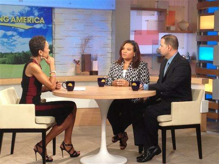 """This image released by ABC shows host Robin Roberts, left, with Juror B29 from the George Zimmerman trial, center, and attorney David Chico on """"Good Morning America,"""" in New York on Thursday, July 25, 2013.  Portions of Roberts' interview with the only minority juror from the Zimmerman trial, will air on """"World News Tonight with Diane Sawyer,""""  and """"Nightline"""" on Thursday and the full interview will air on """"Good Morning America,"""" on Friday. (AP Photo/ABC, Donna Svennevik) Photo: AP / American Broadcasting Companies,"""