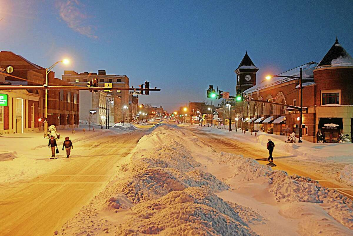 Pedestrians walk along Main Street in Middletown after the February snowstorm.