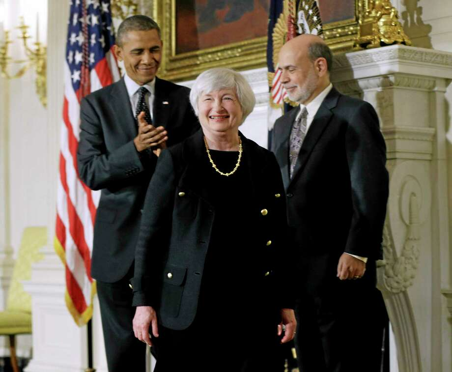 President Barack Obama and Federal Reserve chair Ben Bernanke join Janet Yellen, Obama's nominee to succeed Bernanke, at an announcement Wednesday, Oct. 9, 2013 in Washington. (AP Photo/Pablo Martinez Monsivais) Photo: AP / AP