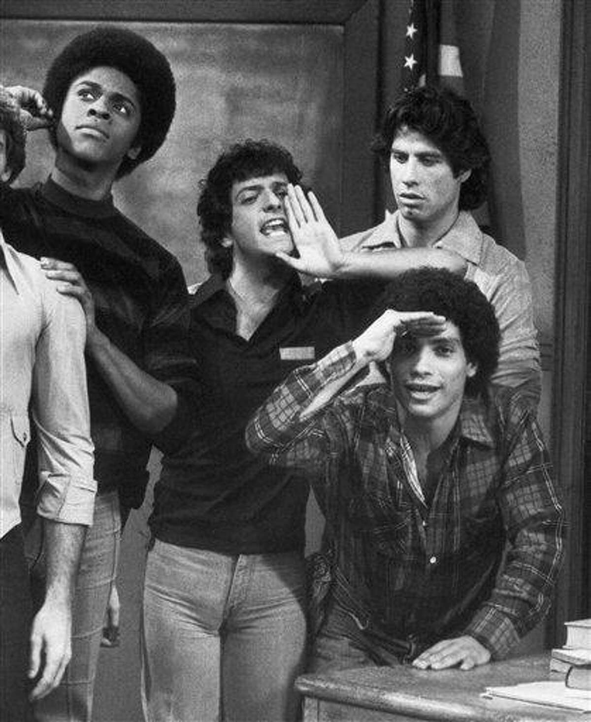 This 1978 file photo originally from ABC shows cast members, from left, Lawrence Hilton-Jacobs as Freddy Washington, Ron Palillo as Arnold Horshack, Robert Hegyes as Juan Epstein, foreground, John Travolta, rear, as Vinnie Barbarino from the television sitcom