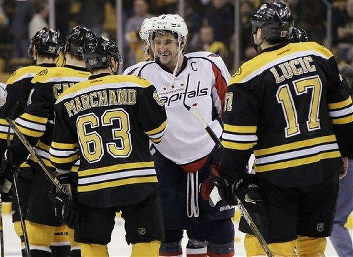Washington Capitals' Alex Ovechkin shakes hands with Boston Bruins' Brad Marchand (63) as Milan Lucic (17) approaches after the Capitals' 2-1 victory in overtime in Game 7 of an NHL hockey Stanley Cup first-round playoff series, in Boston on Wednesday, April 25, 2012. (AP Photo/Elise Amendola)