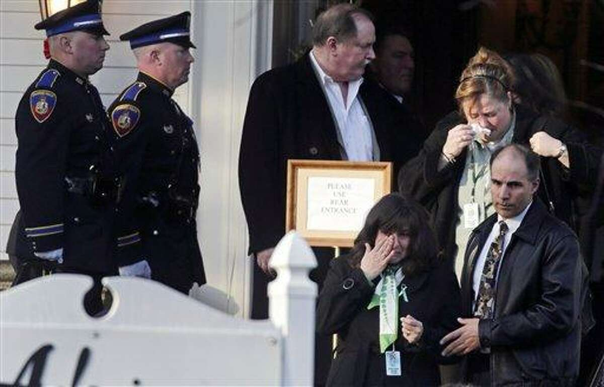 Family and friends react after attending the wake of school shooting victim Victoria Soto, a teacher at Sandy Hook Elementary School, in Stratford, Conn., Tuesday, Dec. 18, 2012. Soto, 27, was killed when Adam Lanza walked into Sandy Hook Elementary School in Newtown, Conn., Dec. 14, and opened fire, killing 26 people, including 20 children, before killing himself. (AP Photo/Charles Krupa)