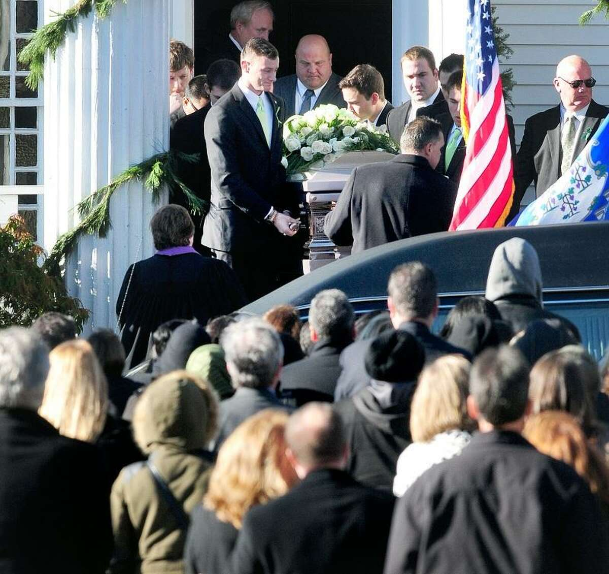 Pallbearers carry the casket of Victoria Soto from the Lordship Community Church in Stratford after funeral services on 12/19/2012. Photo by Arnold Gold/New Haven Register