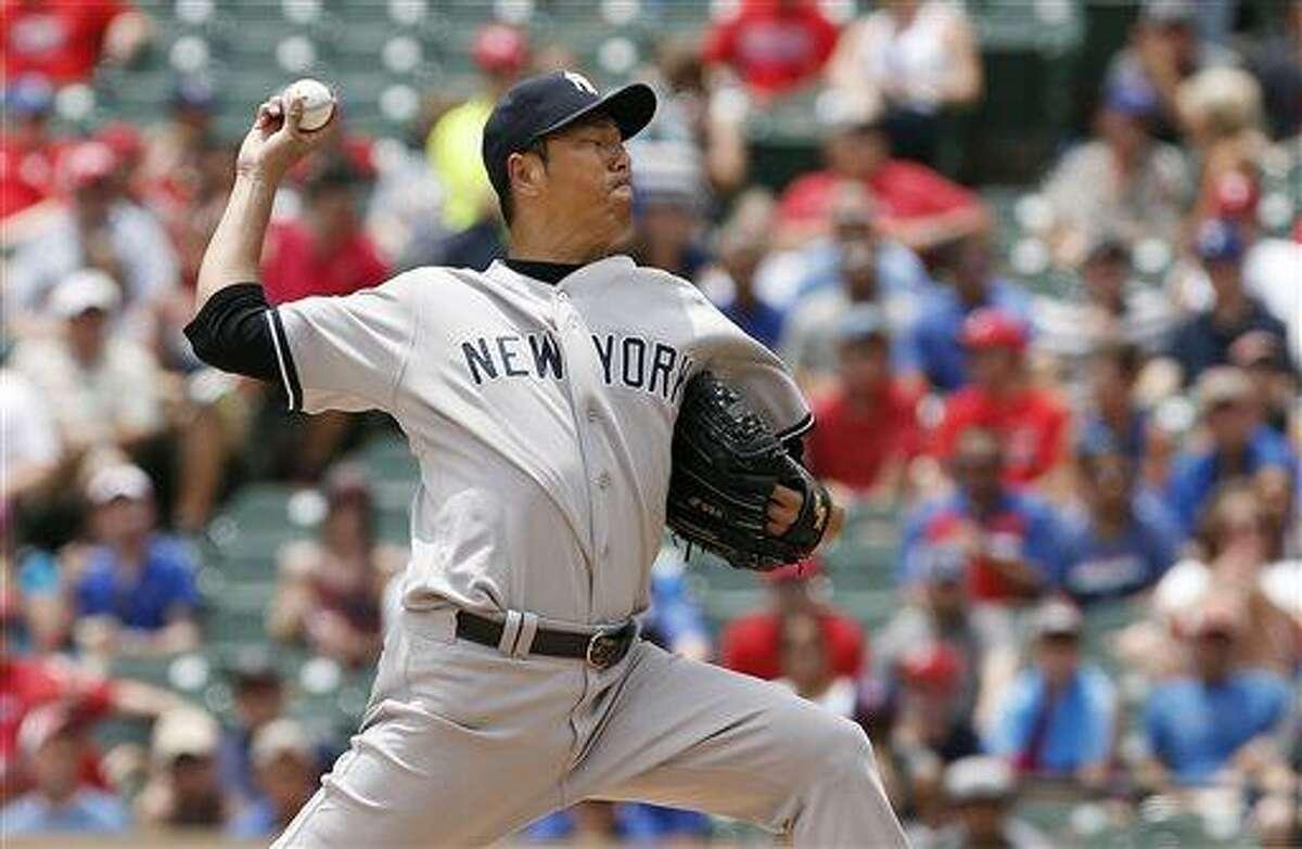 New York Yankees starting pitcher Hiroki Kuroda, of Japan, throws in the first inning of a baseball game against the Texas Rangers in Arlington, Texas, Thursday, July 25, 2013. (AP Photo/Brandon Wade)