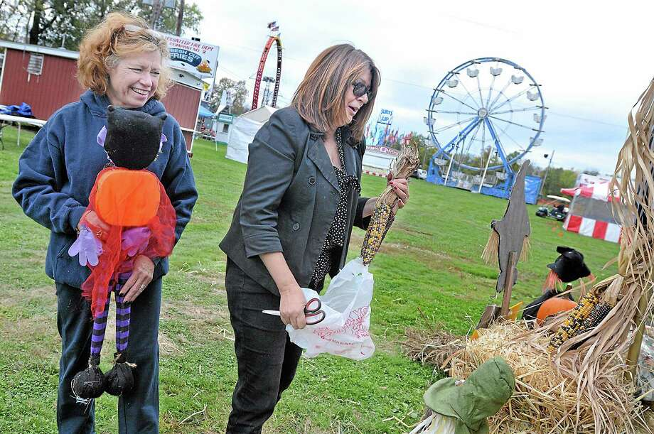 Portland River Valley Garden Club secretary, Margaret Stewart, left, and treasurer, Debbie Hallas work on a display at the Portland Fair Thursday afternoon. All three garden clubs in town, the Portland Garden Club and Brownstone Garden Club are invited to create focal points to decorate the fairgrounds at fair time. Catherine Avalone - The Middletown Press Photo: Journal Register Co. / TheMiddletownPress