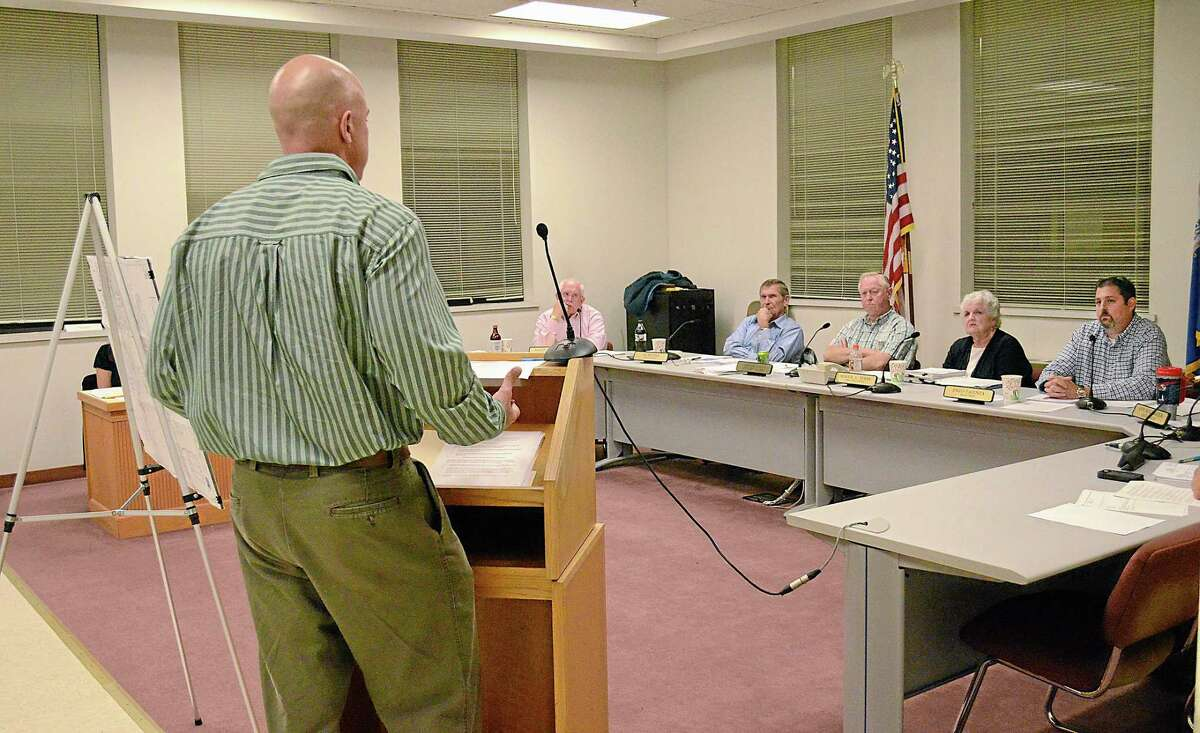 Jon Harriman, Cromwell's Town Engineer, speaks to the Board of Selectmen at their last meeting on Wesnesday before the transition to a Town Council. Brittany Hill - Middletown Press Intern