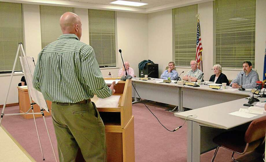 Jon Harriman, Cromwell's Town Engineer, speaks to the Board of Selectmen at their last meeting on Wesnesday before the transition to a Town Council. Brittany Hill - Middletown Press Intern Photo: Journal Register Co.
