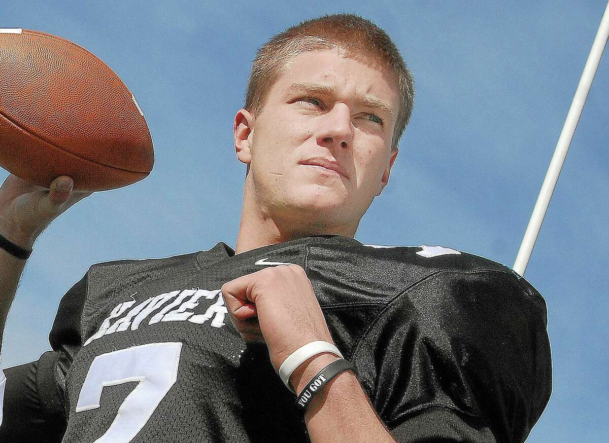 Middlefield's Tim Boyle, a UCONN freshman will debut as starting quarterback against South Florida at noon on Saturday at Rentschler Field in East Hartford. Catherine Avalone - The Middletown Press