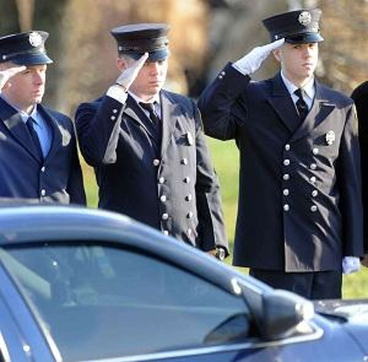 Connecticut firefighters from around the state stand as an honor guard during the funeral for Daniel Barden , 7, of at the St. Rose of Lima Roman Catholic Church in Newton, Conn. Wednesday, December 19, 2012, who was killed by a gunman that also claimed the lives of 6 adults and 19 other children at the Sandy Hooky Elementary School shooting Friday, December 14, 2012. Photo by Peter Hvizdak / New Haven Register