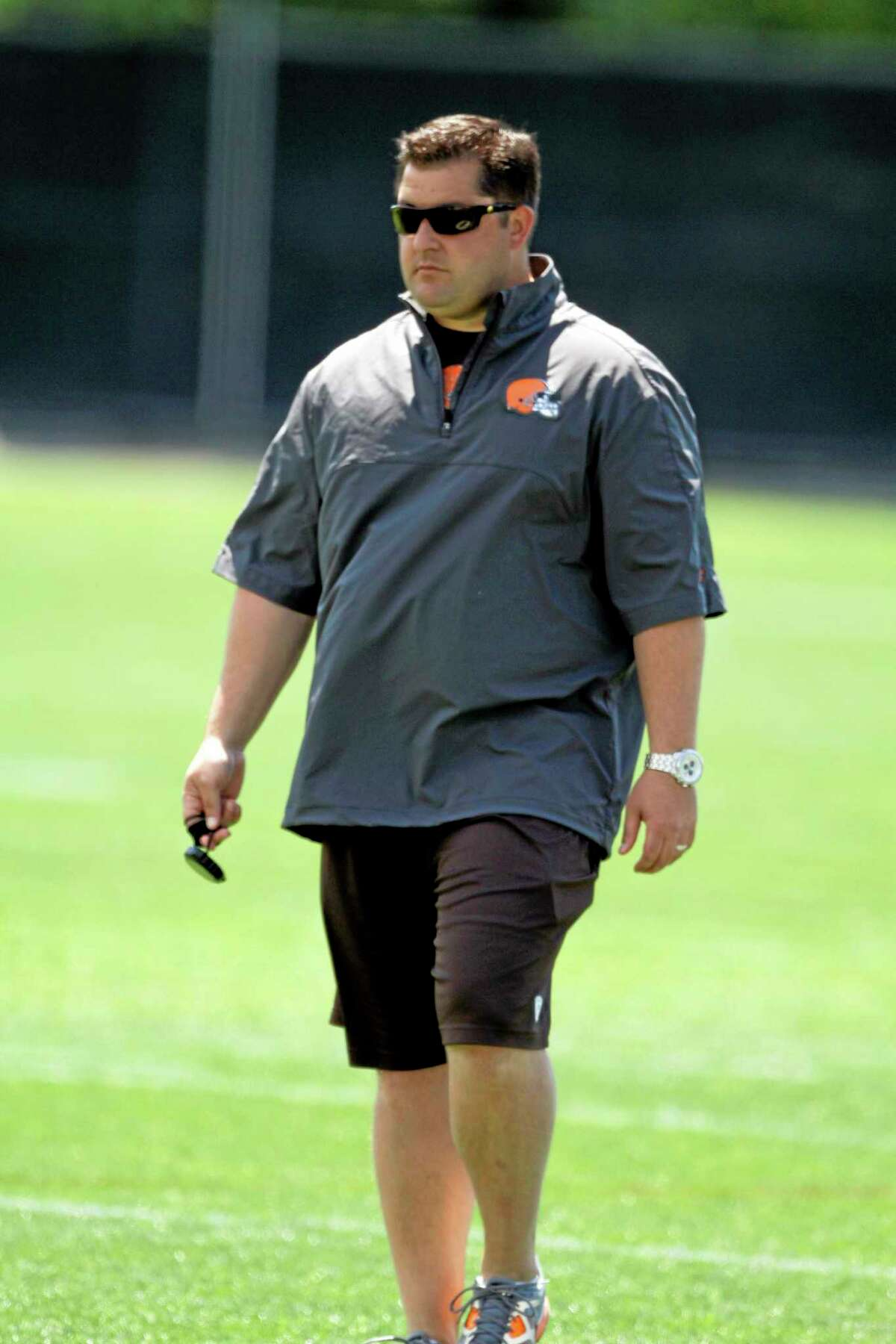 In this June 7, 2012 photo, Cleveland Browns director of player personnel Jon Sandusky watches practice at the team's headquarters in Berea, Ohio. Jon Sandusky, the son of former Penn State assistant coach Jerry Sandusky, was arrested early Tuesday morning on suspicion of drunken driving. Fargo, N.D. police Lt. Joel Vettel told The Forum of Fargo-Moorhead that an officer spotted Jon Sandusky, 36, making an illegal turn. The officer pulled Sandusky over and decided he was driving under the influence after administering field sobriety tests.