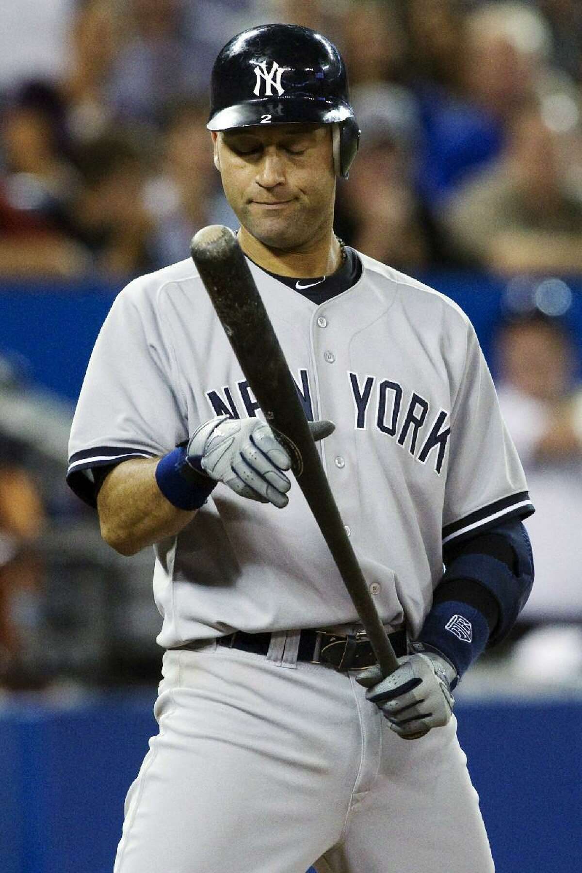 AP PHOTO/The Canadian Press, Chris Young New York Yankees' Derek Jeter reacts after a strike against the Toronto Blue Jays during the ninth inning of Sunday's game in Toronto. The Blue Jays won 10-7.