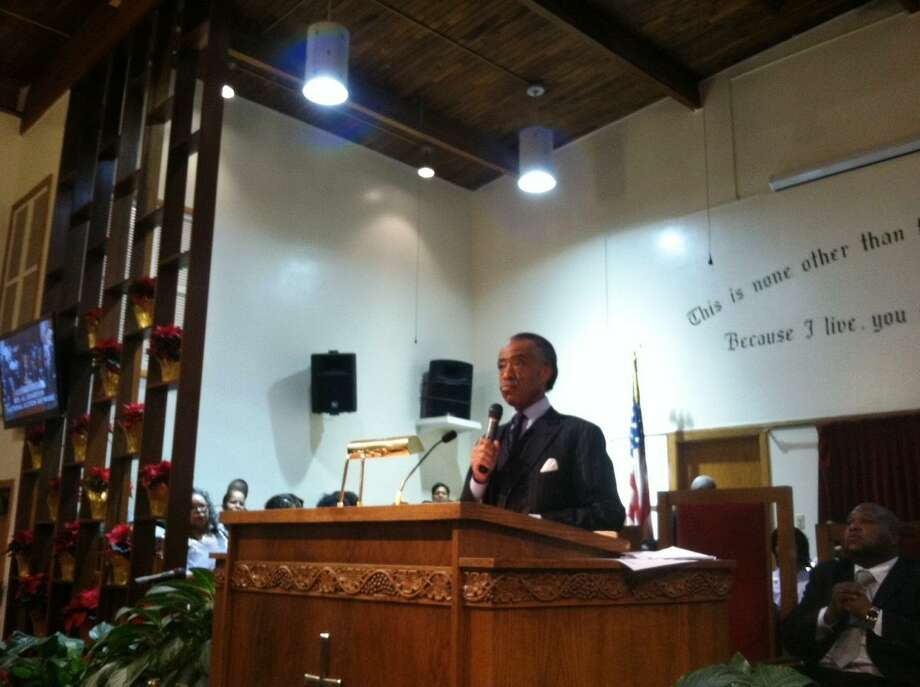 The Rev. Al Sharpton called for stricter gun measures as he joined the Connecticut State Missionary Baptist Convention on Tuesday at Zion Baptist Church for a prayer vigil and service for the victims and survivors of the Newtown tragedy.  Photo by Shahid Abdul-Karim