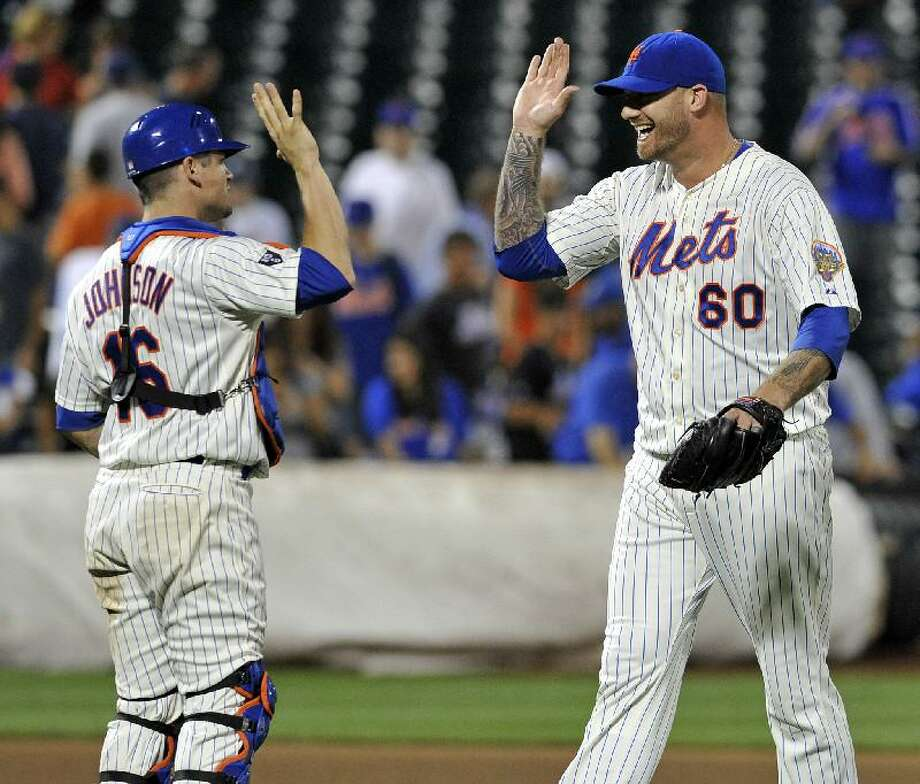 ASSOCIATED PRESS New York Mets pitcher Jon Rauch (60) celebrates with catcher Rob Johnson after the Mets defeated the Atlanta Braves, 6-5, in Sunday night's game at Citi Field in New York.