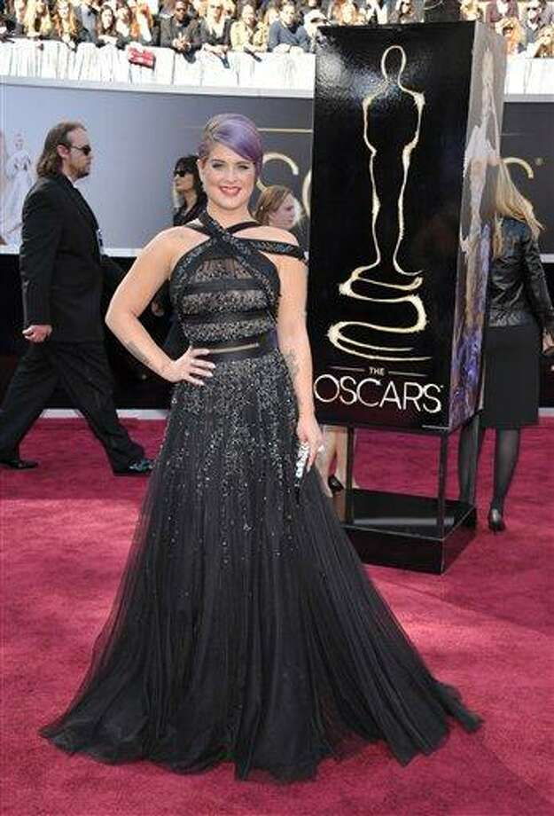 """FILE - In this Sunday, Feb. 24, 2013 file photo, TV personality Kelly Osbourne arrives at the 85th Academy Awards at the Dolby Theatre in Los Angeles.  Osbourne has been hospitalized after fainting on the set of E!'s """"Fashion Police."""" A spokeswoman for Osbourne told the cable network Thursday, March 7, 2013, that the 28-year-old TV personality is awake, alert and in stable condition, and she will be staying overnight for observation as a precautionary measure.  (Photo by John Shearer/Invision/AP, File) Photo: John Shearer/Invision/AP / Invision"""